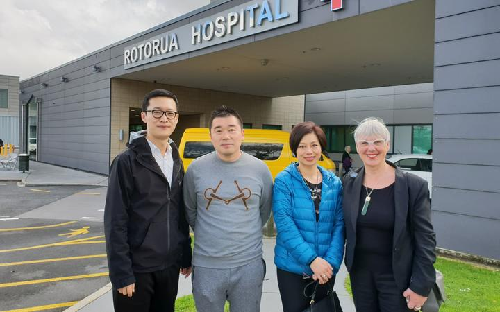 Robert Liu, second from left, and Mayor Steve Chadwick, right, with 