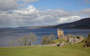 Urquhart Castle, built 13th - 16th centuries, on the shores of Loch Ness in the Great Glen, Highlands, Scotland. The castle was captured by Edward I of England in 1296 during the Wars of Scottish Independence and was destroyed by government troops in the Jacobite Risings.