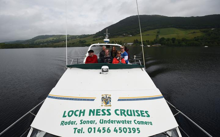 Tourists take a cruise aboard the 'Nessie Hunter' boat on Loch Ness in the Scottish Highlands, Scotland on June 10, 2018.