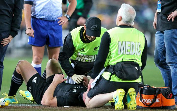 Ryan Crotty down injured while All Blacks doctor Tony Page attends to him. Australian Wallabies v New Zealand All Blacks. Rugby Union. First Bledisloe Cup and Rugby Championship match of 2018. ANZ Stadium, Sydney, Australia, 18 August 2018. Copyright Photo: David Neilson / www.photosport.nz