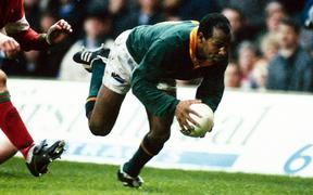 Chester Williams looks to score a try during the international rugby union match between South Africa and Wales, 1994. Photo: Offisde/PHOTOSPORT