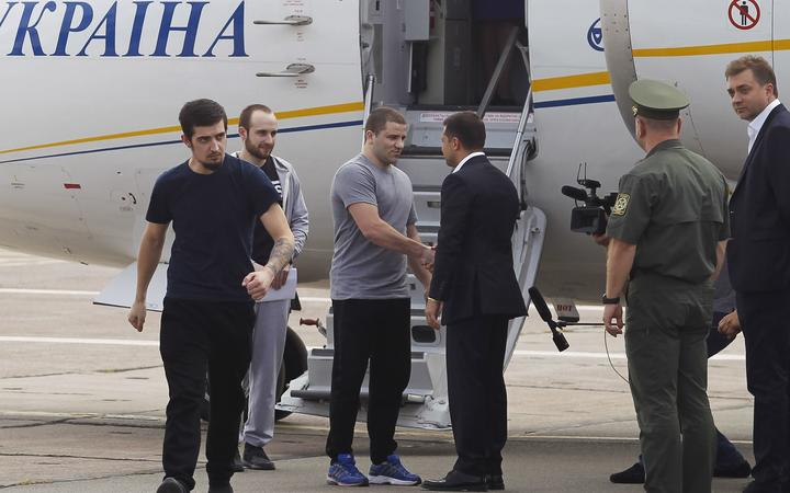 Ukrainian President Volodymyr Zelensky (3-R) welcomes released Ukrainians, who were  jailed in Russia, upon their arrival at the Borispil International Airport near Kiev, Ukraine, on 07 September, 2019