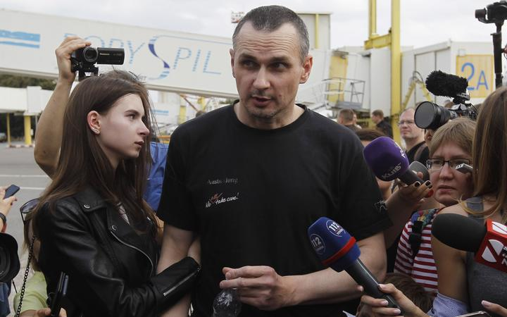 Ukrainian film director Oleg Sentsov, who was jailed on terrorism charges in Russia,  hugs his daughter Alina Sentsova, upon arrival after Russia-Ukraine prisoners swap, at Borispil International Airport near Kiev, Ukraine, on 07 September, 2019