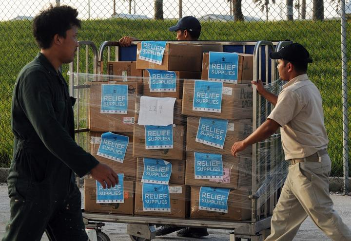 Crew members of Royal Caribbean International's Mariner of the Seas offload 20,000 meals prepared for Hurricane Dorian victims on September 7, 2019 in Freeport, Bahamas.