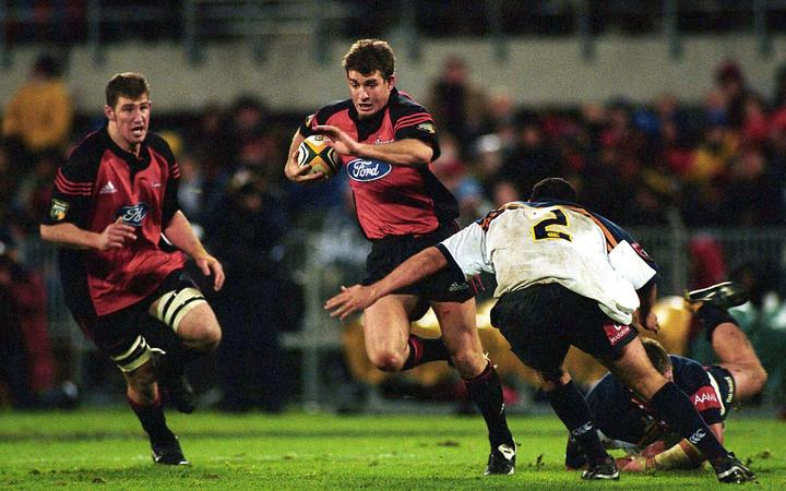 Mark Robinson in action during the rugby union Super 12 final between the Crusaders and Brumbies, Jade Stadium, Christchurch, 25 May, 2002. Photo: PHOTOSPORT