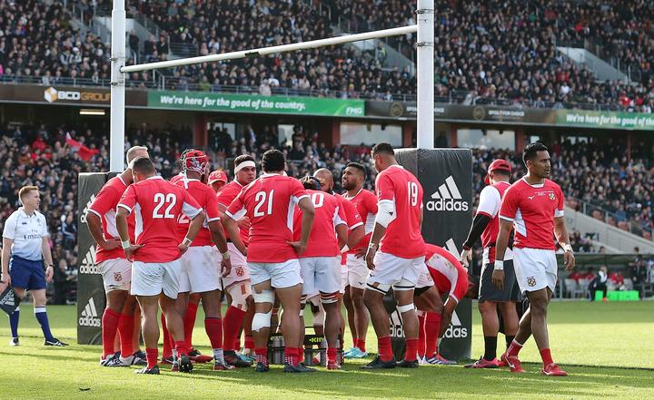 Tonga regroup under their posts after one of the 14 tries they conceded against the All Blacks in Hamilton.