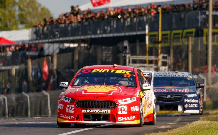 Scott McLaughlin crosses the finish line to win race two of the 2018 Supercars event at Pukekohe ahead of fellow Kiwi driver Shane van Gisbergen.