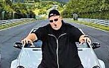 Kim Dotcom with seized cars.