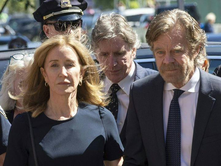 Actress Felicity Huffman, escorted by her husband William H. Macy, makes her way to the entrance of the John Joseph Moakley United States Courthouse September 13, 2019 in Boston.