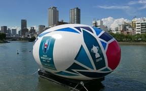 A giant rugby ball balloon floats on a river to promote the Rugby World Cup in Osaka,.