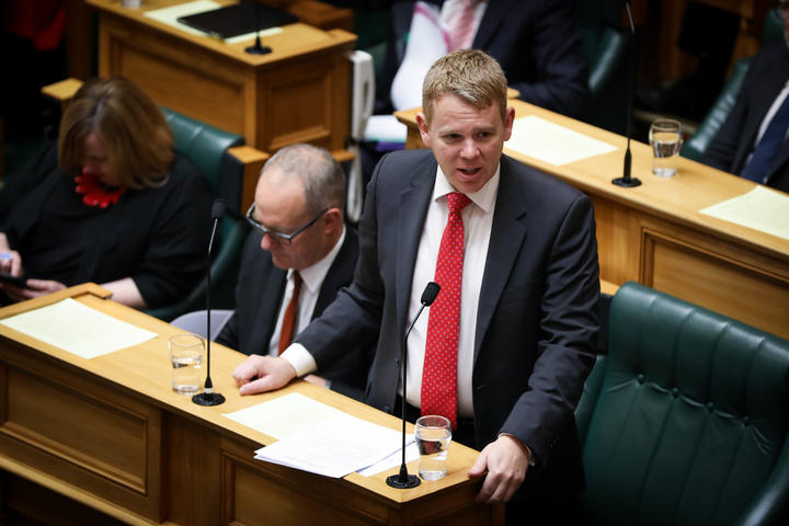 Minister of Education Chris Hipkins answers questions in the debating chamber.