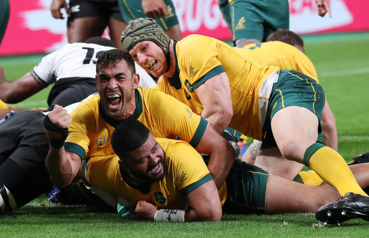 Australia's Tolu Latu celebrates after scoring one of his tries during the second half of the match against Fiji at the Rugby World Cup.