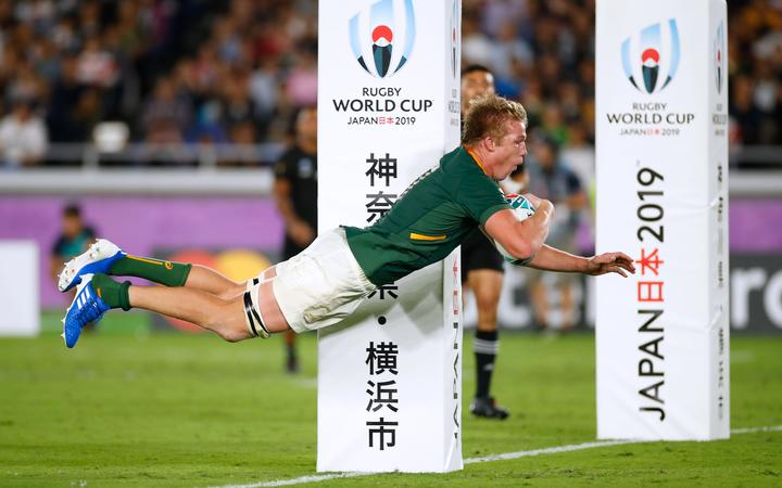 South Africa's flanker Pieter-Steph Du Toit dives and scores a try.