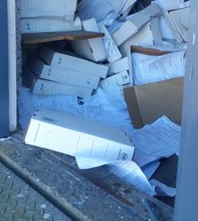 Council documents at the damaged building.