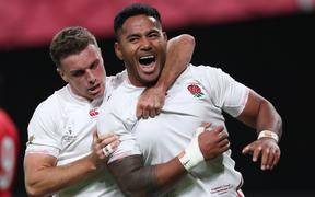 Manu Tuilagi of England reacts after trying in the first half of the Pool C match in the 2019 Rugby World Cup Japan against Tonga.