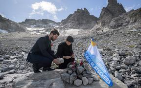 People take part in a ceremony to mark the 'death' of the Pizol glacier (Pizolgletscher) on September 22, 2019 above Mels, eastern Switzerland.