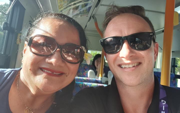 Josie Tada and Joe Porter on a bus in Japan.