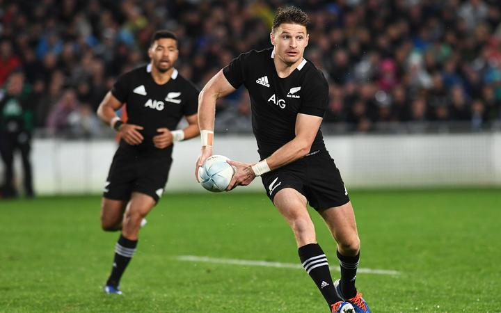 Beauden Barrett makes a break with Richie Mo'unga in support.