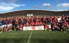 The New Zealand Defence Force rugby team alongside France following their third-place playoff match in Japan.