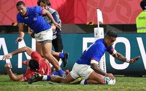 Samoa's centre Rey Lee-Lo (R) scores a try  during the Japan 2019 Rugby World Cup Pool A match between Russia and Samoa at the Kumagaya Rugby Stadium in Kumagaya.