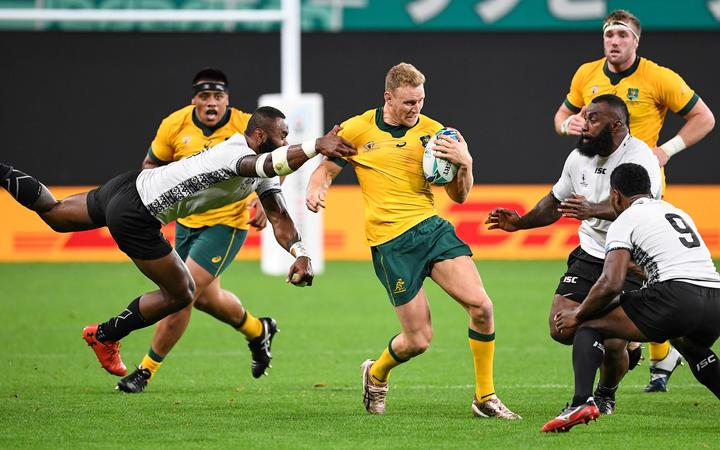 Australia's wing Reece Hodge is tackled during the Japan 2019 Rugby World Cup Pool D match between Australia and Fiji at the Sapporo Dome.