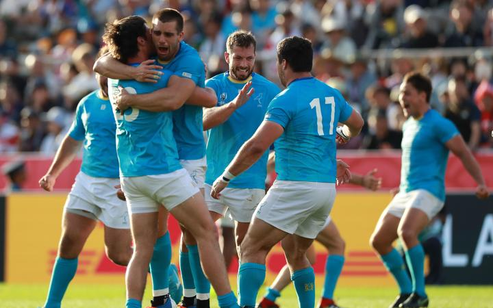 Uruguay's players celebrate after winning the Pool D match against Fiji in the 2019 Rugby World Cup Japan