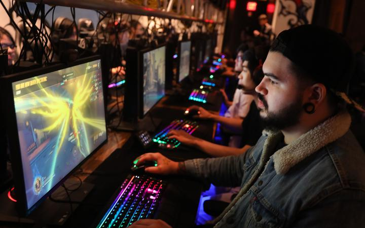 People play video games at the newly launched OS NYC, a fully equipped gaming lounge on September 19, 2019 in New York City. Re downloaded on 9 March 2020.