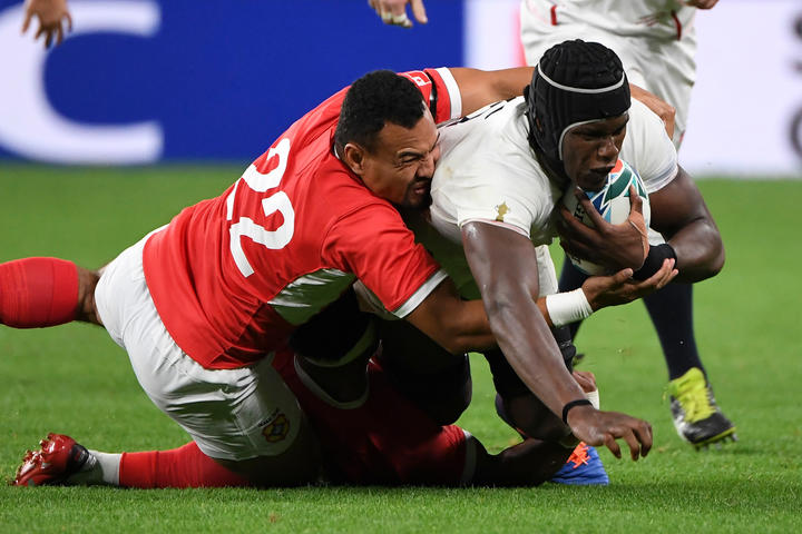 James Faiva tackles England lock Maro Itoje during Tonga's 2019 Rugby World Cup opener.