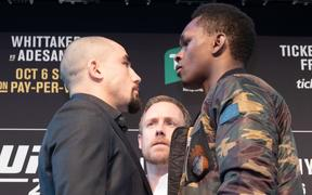 Robert Whittaker and Israel Adesanya face off.