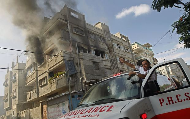 Smoke rises from a building after an Israeli strike on Rafah in the southern Gaza Strip on Thursday.
