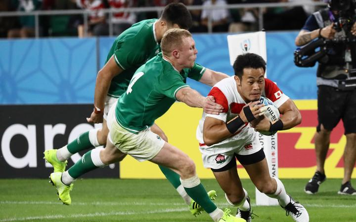 Japan's Kenki Fukuoka (R) scores a come-from-behind try during the first second  of the Rugby World Cup Pool A match against Ireland at Shizuoka Stadium Ecopa in Fukuroi in Shizuoka Prefecture on Sept. 28, 2019.