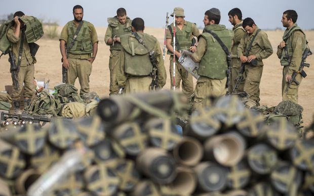 Israeli soldiers on the southern Israeli border with the Gaza Strip after the proposed three-day truce collapsed.