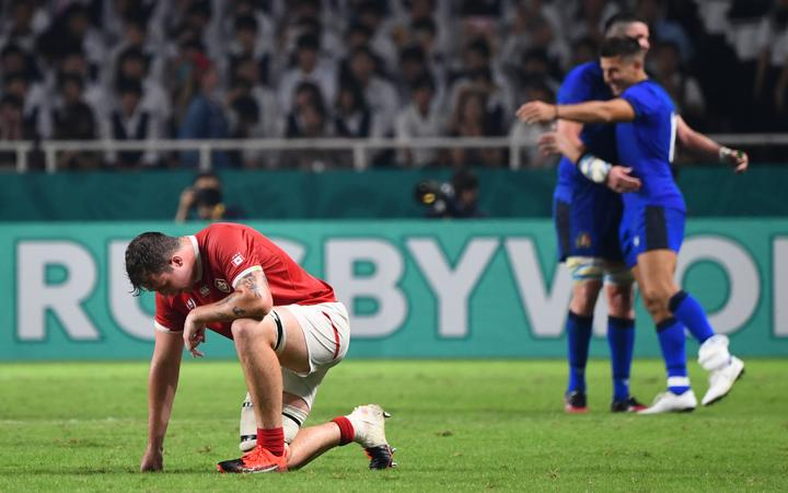 Canada's lock Conor Keys (L) reacts after losing  during the Japan 2019 Rugby World Cup Pool B match between Italy and Canada.
