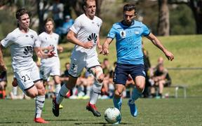 Sydney FC striker Kosta Barbarouses in pre-season action for the Sky Blues against one of his old clubs the Wellington Phoenix.