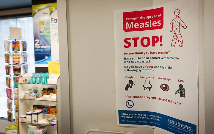 A poster at a medical centre warns against the spread of measles.