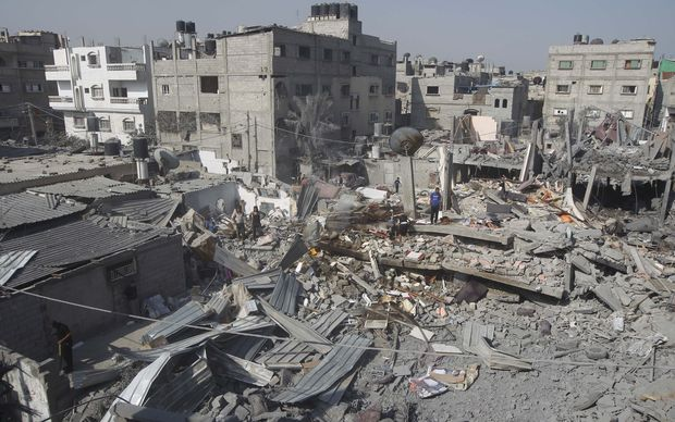 Palestinians inspect the wreckage of a building hit in an Israeli air strike in Rafah, in the southern Gaza Strip.