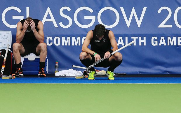 Dean Couzins (L) and Simon Child of New Zealand dejected after losing the bronze medal match.