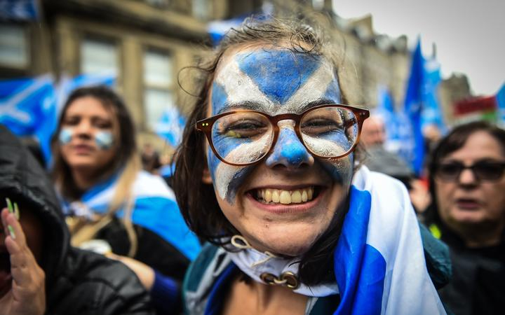 Demonstrators attend a pro-independence march from Holyrood to the Meadows in Edinburgh, Scotland on October 5, 2019.