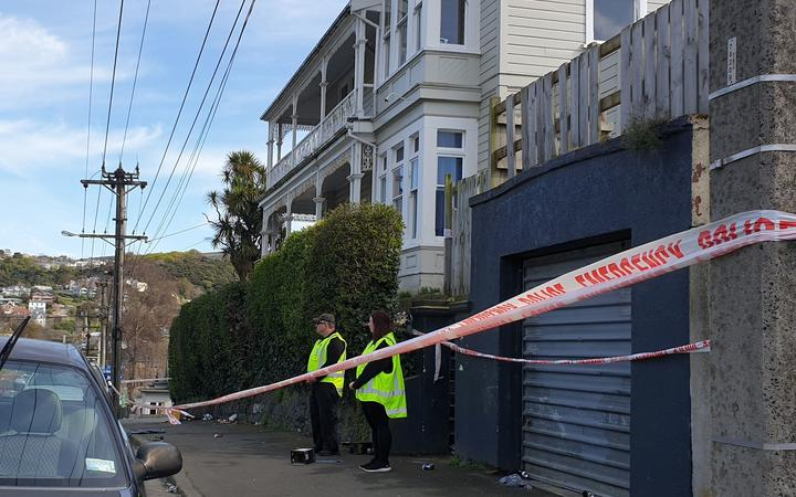 Security guards outside house where woman died in Dunedin - Dundas Street
