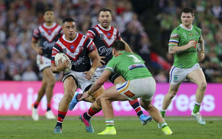 Siosiua Taukeiaho looks to take on the tackle of Charnze Nicoll-Klokstad. Sydney Roosters v Canberra Raiders, NRL Grand Final, Rugby league, ANZ Stadium, Sydney, Australia, 6 October 2019.