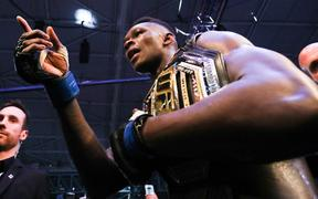 Israel Adesanya celebrates after defeating Robert Whittaker of Australia during the middleweight title bout of the UFC 243 fight night in Melbourne on October 6, 2019