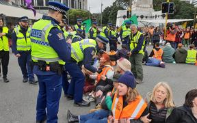 Police talk to climate change protesters in Wellington.