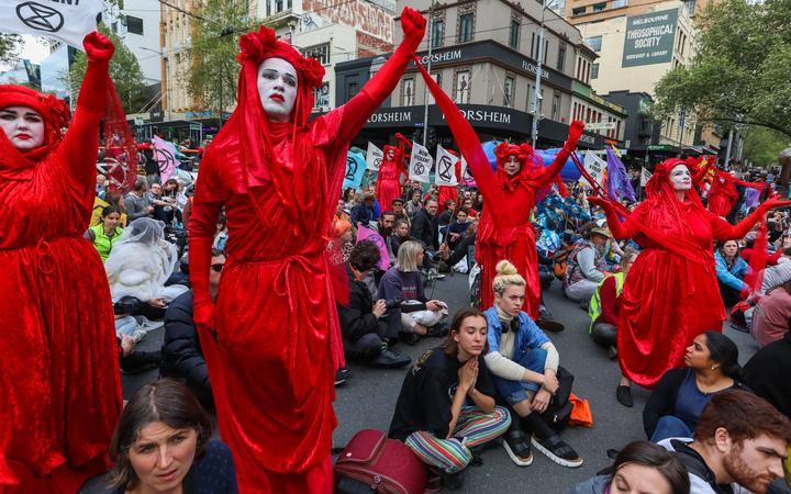 Demonstrators stage a sit-in on a road during a Extinction Rebellion protest in Melbourne on October 7, 2019.