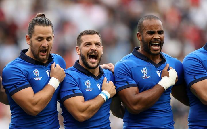 Italy's players put there hearts into a powerful rendition of the national anthem.
