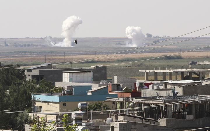 SANLIURFA, TURKEY - OCTOBER 10: Smoke rises after howitzers of Turkish Armed Forces hit terror targets in Tell Abyad  in northern Syria, against PKK/YPG, Daesh terrorists, on October 10, 2019 in Sanliurfa, Turkey.