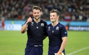 Peter Horne - Scotland centre along side his treble scoring brother George at the end of the match as both players celebrate a 61-0 victory over Russia.