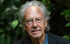 Austrian writer Peter Handke poses in Chaville, in the Paris surburbs, on October 10, 2019 after he was awarded with the 2019 Nobel Literature Prize. -