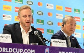 Rugby World Cup tournament director Alan Gilpin (L).