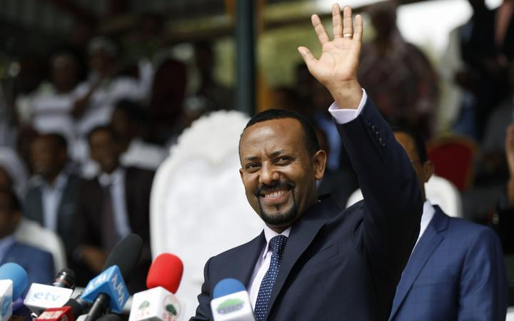 (FILES) In this file photo taken on April 11, 2018 New Ethiopian Prime Minister Abiy Ahmed waves during his rally in Ambo, about 120km west of Addis Ababa, Ethiopia.