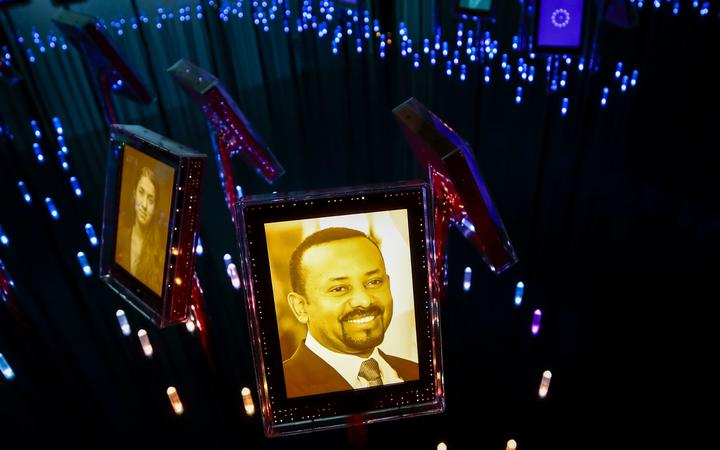A picture of the 2019 Nobel Peace Prize laureate Ethiopian Prime Minister Abiy Ahmed Ali is on display at the Nobel Peace Center in Oslo on October 11, 2019.